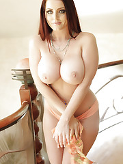 Sophie Dee strips at the top of the stairs!