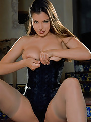 Aria Giovanni demonstrates big tits in a lingerie