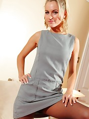 Natasha Anastasia in a grey minidress, black pantyhose and..