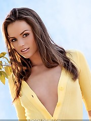 strips out of her yellow shirt and white panties