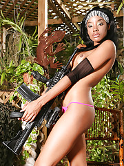 Ebony action girl Nina with a huge gun