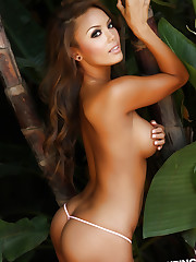 Busty vixen Justene teases in and out of her camo covered..