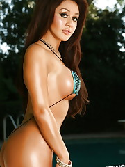 Sexy vixen Joselyn is barely covered by her extremely tiny..