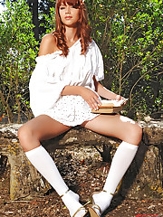 Kami strips outdoors showing legs