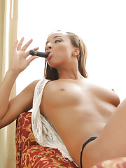 Gorgeous Nubile tickles her throbbing clit with a vibrator