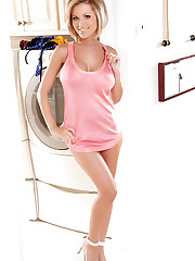 Brunette Jenny P doing laundry in her pink shirt