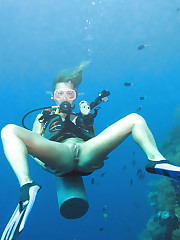Diving beauty strips underwater