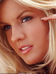 is a stunning British blonde with blue eyes