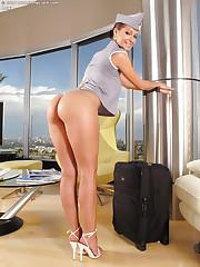 Naughty flight attendant strips