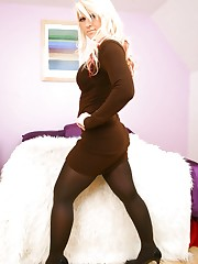 Nikki Lee in smart brown minidress and brown pantyhose.