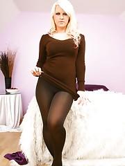 Nikki Lee in smart brown minidress and brown pantyhose.