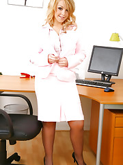 Busty office girl Cherry D undresses in her office chair..