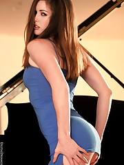 Playing piano in sexy blue dress