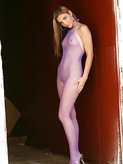 Wearing a purple fishnet body stocking