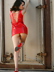 Carmen peels out of her ultra sexy red vinyl dress!