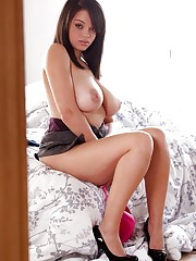 strips down on her bed