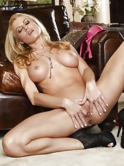 Randy Moore exposes her juicy nipples and stimulates herself