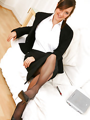 Stunning executive secretary Nadia E finishes off her work..