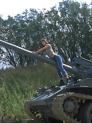 Veronica Zemanova undresses outdoors on her war machine