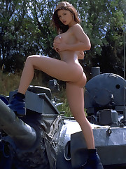 Veronica Zemanova undresses outdoors on her war machine