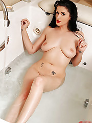 Bathing beauty spreading real wide!