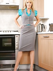 Mackenzie dressed in a grey secretary outfit with a blue..