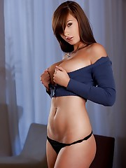 pops her large natural breast out of a tight blue sweater