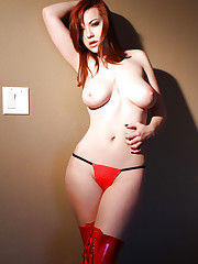 Busty redhead Katlynn demonstrates her natural big tits