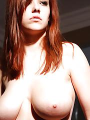 Busty redhead Katlynn demonstrates her natural big tits