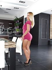 Horny blonde sprawled on the table
