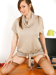 Lovely Nadia E teases us in her office as she slips off..