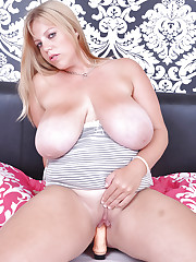 Angel fucks her tits and cunt with a toy