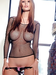 in a fishnet top and pink panties