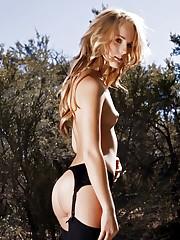 Blonde looks amazing in her black lingerie.