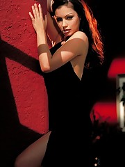 busts out her wonders from her black dress