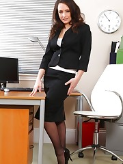 Sexy dark haired secretary teases her way out of her smart..