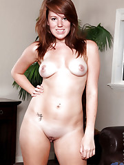 Totally naked Lizzie Tucker posing as if wanting to have..