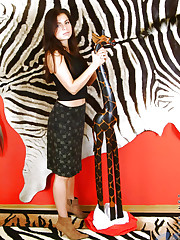 A very naked danica stands next to a wooden giraffe wtf..