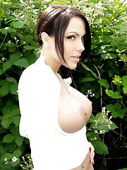 Katie Banks whips her breasts out of a sweater.