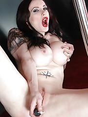 Morrigan licks her juggs and dildo fucks