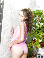 Curly haired teenie inching her shirt wants to get naked..