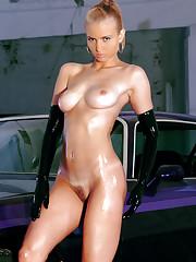 Action porn model Megan posing at a muscle car