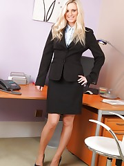 Meklaina looks smart and sexy in her black skirt suit,..