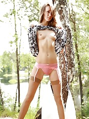 Gorgeous brunette hides cute pink lingerie and tan..