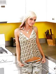 Luscious teen enjoys on kitchen takes off her clothes..