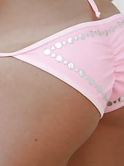 Ashley loves to tease us in her cute little pink bikini!
