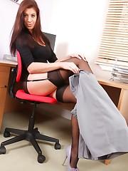 Beautiful secretary posing in the office.