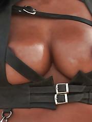 Rita G reveals her Ebony big tits and gun