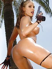 Erika Jordan demonstrates her big tits and her gun