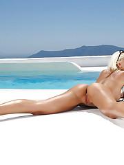 Beach babe strips off her gold bikini